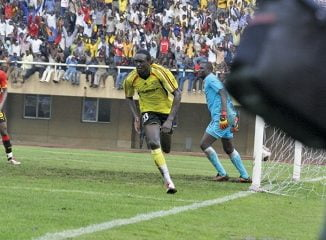 David Obua in action at a football game in Namboole Stadium.