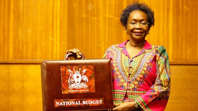 Hon. Maria Kiwanuka readt to present the 2011 budget at parliament