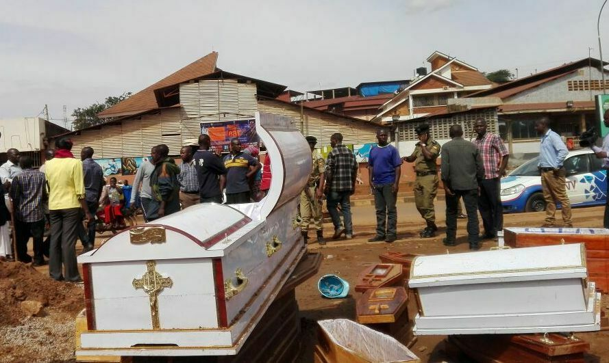Traders Carry Coffins into Kakande's Church