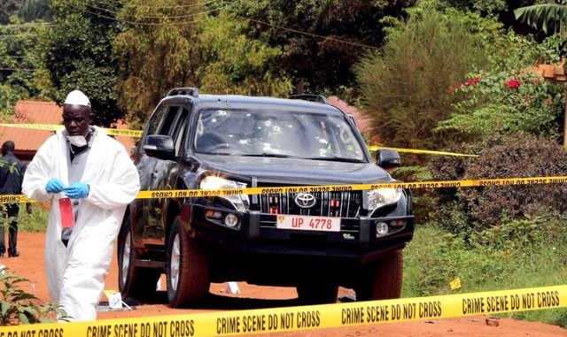 Forensic investigation officers at the scene where Kaweesi was shot