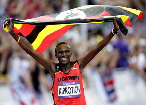 Uganda's Stephen Kiprotich celebrates with his national flag after winning men's marathon at London 2012 Olympic Games
