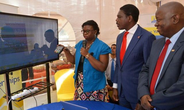 URA Commissioner General Doris Akol, Johnson Agoreyo, Managing Direstor UBA and Victor Ndlovu, VISA's Managing Director