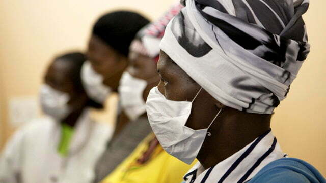 Patients with HIV and tuberculosis wear masks while awaiting consultation