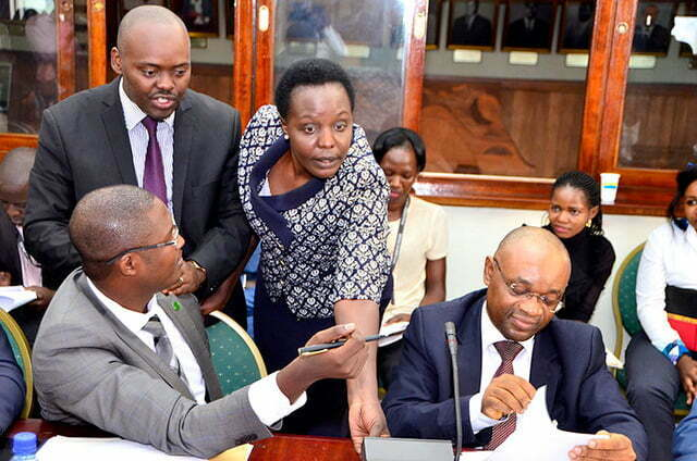 Monica Amoding attempts to switch off Raphael Magyezi's microphone. Courtesy Photo.