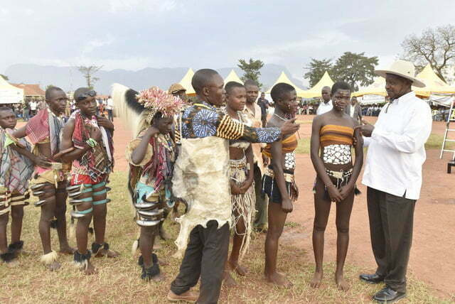 President Museveni talking to members of a traditional dance group