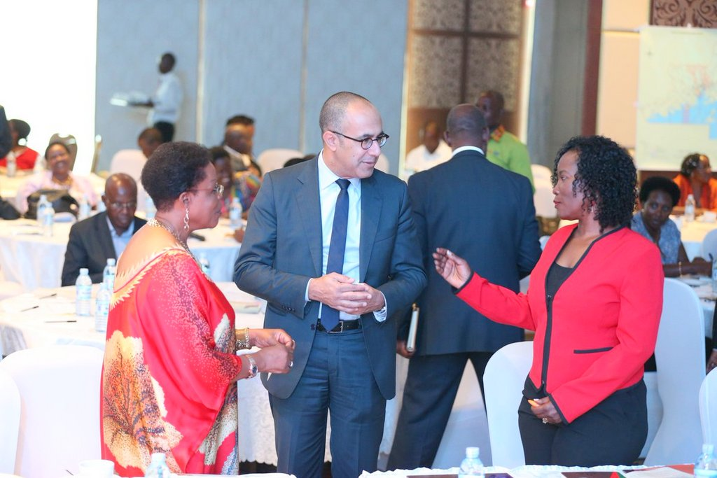 Kampala Minister Beti Kamya, KCCA ED Jeniffer Musisi chatting with World Bank officials at the report launch