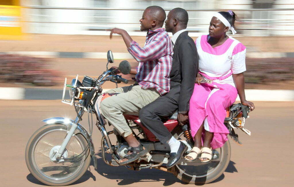 Kasese police stops Boda bodas from carrying two passengers