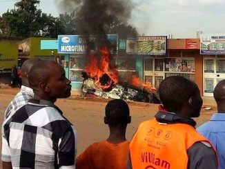 Motorist hits taxi driver with a hoe on the head, mob sets vehicle ablaze in Nansana