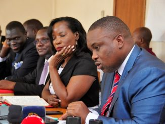 Kampala Lord Mayor Erias Lukwago (R) and outgoing Kampala Capital City Authority executive Director Jennifer Musisi (C) while appearing before the parliamentary committee on Presidential Affairs to respond to questions arising from the recent conduct of KCCA law enforcement officers last year