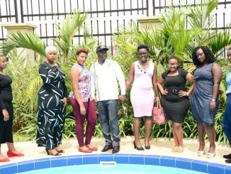 The State Minister in-charge tourism Godfrey Kiwanda poses with ladies during the launch of Miss Curvy beauty pageant.