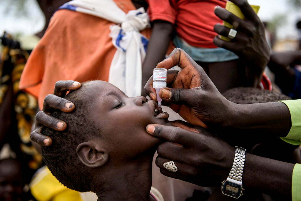 A child receives an oral Polio Vaccine