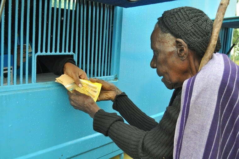 Elderly-woman-being-paid-SAGE-funds
